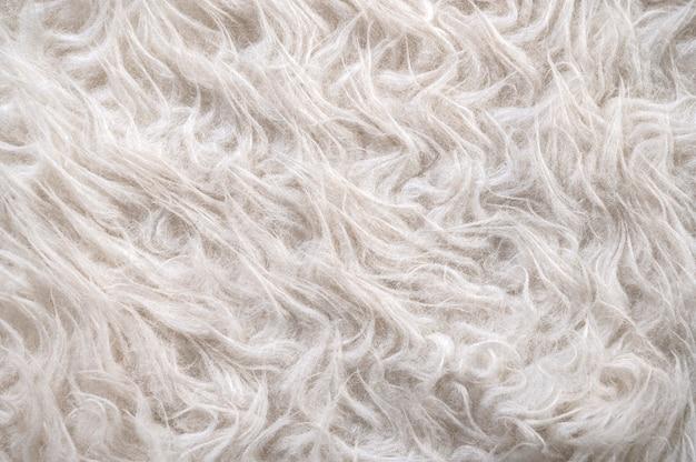 Close up dettaglio di pelliccia artificiale. sfondo astratto pronto per il design