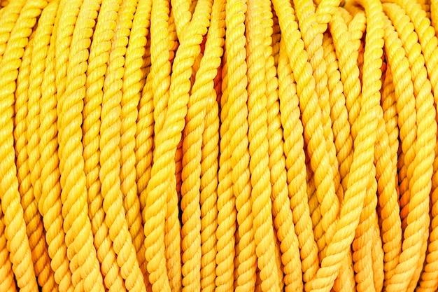 Close up dettaglio di nautica industriale marine giallo corda bobina sfondo