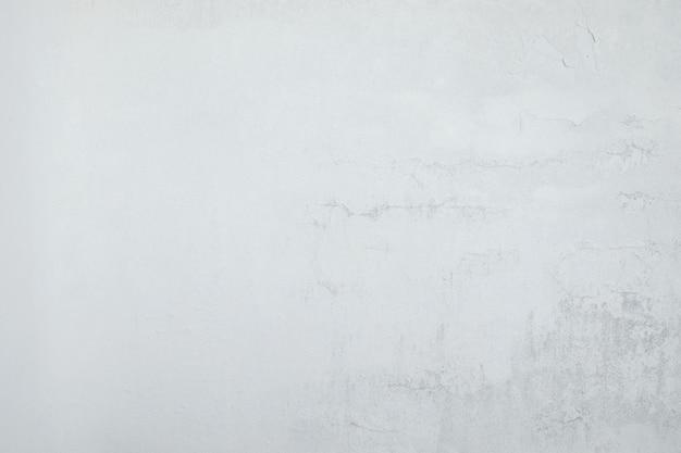 Chiuda sul fondo concreto bianco di struttura del dettaglio