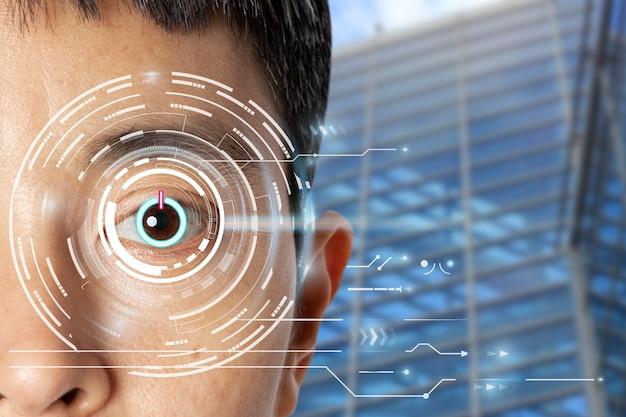Primo piano dell'occhio in fase di scansione con informazioni digitali sulla tecnologia dell'icona del pulsante di accensione.