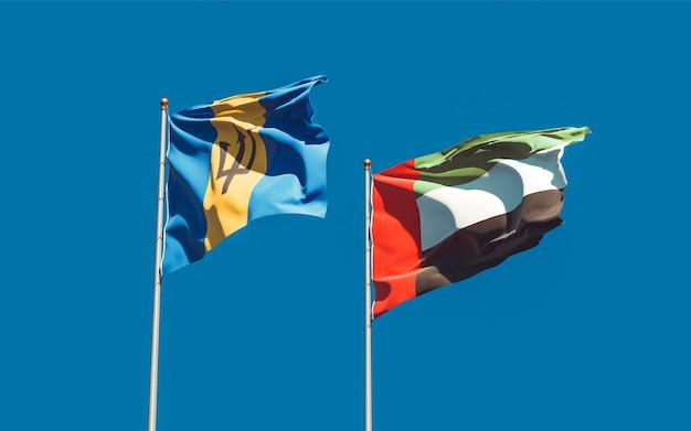 Primo piano sulle bandiere degli emirati arabi uniti, emirati arabi uniti e barbados