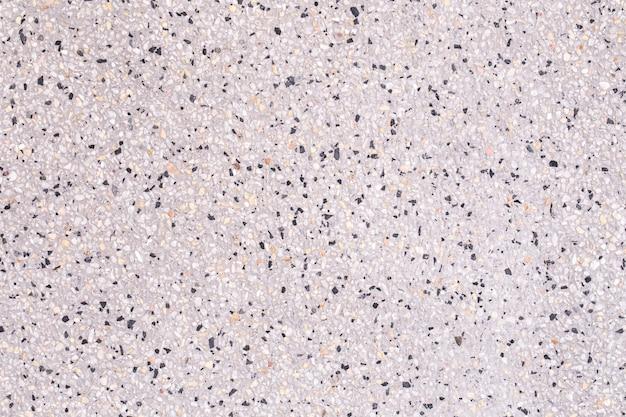 Chiuda su fondo modellato superficie del marmo del granito, modelli sulla superficie della pietra del granito, struttura dell'estratto di lerciume del fondo della parete di pietra
