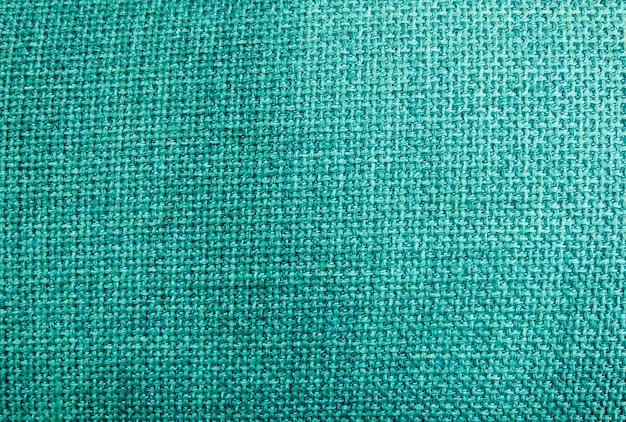 Chiuda su del fondo verde del modello di struttura del tessuto della tela da imballaggio o del sacco nel tono di colori pastelli.