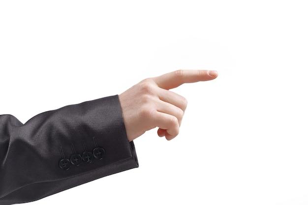 Avvicinamento. mano di un imprenditore che punta a una copia space.isolated su sfondo grigio.