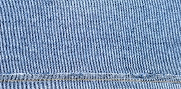 Chiuda in su della superficie interna di struttura delle blue jeans.