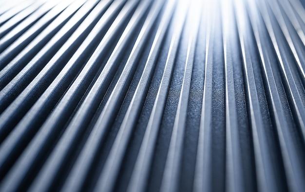 Primo piano di una superficie ondulata in ferro di un dispositivo