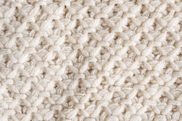 Primo piano sulla trama del tessuto di lana lavorata a maglia