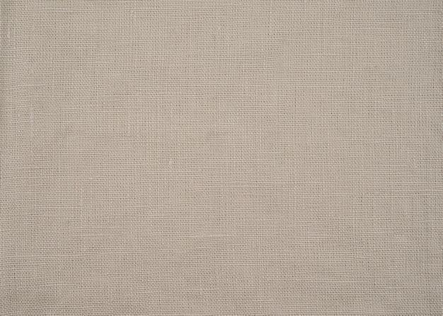 Struttura di tela del primo piano del tessuto o del panno organico beige naturale Foto Premium