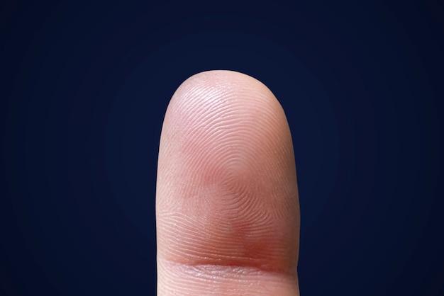 Un primo piano di identificazione dell'impronta digitale umana macro, sicurezza della privacy privacy