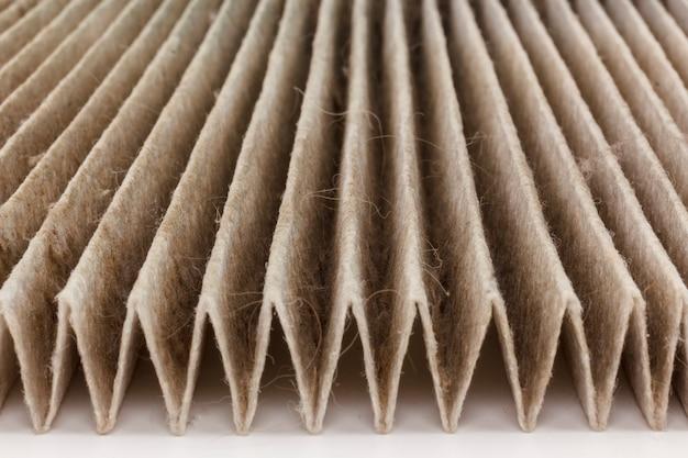Close up macro molto sporco usato lo sfondo del filtro dell'aria. vecchia automobile sporca del filtro dell'aria