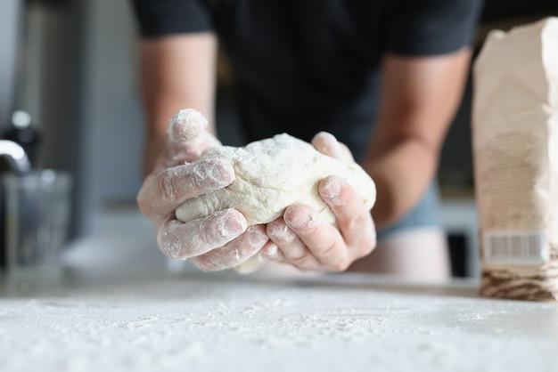 Close up man holding pasta