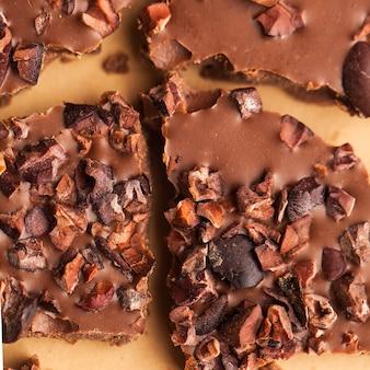 Cioccolato al latte del primo piano, carta da parati dell'alimento, struttura, superficie
