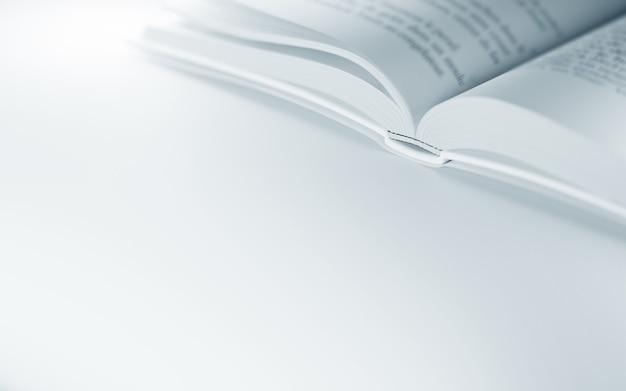 Primo piano del libro aperto sulla superficie bianca