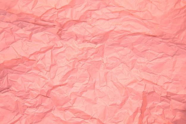 Primo piano di rughe rosa vecchio sgualcito con sfondo ruvido di carta pagina texture.