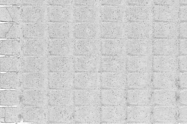 Chiuda in su di un intonaco della parete e del cemento del plasterboard