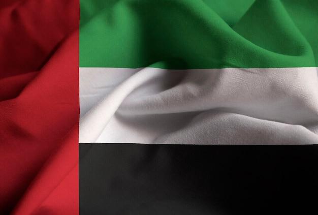 Chiuda in su della bandiera arruffata degli emirati arabi uniti