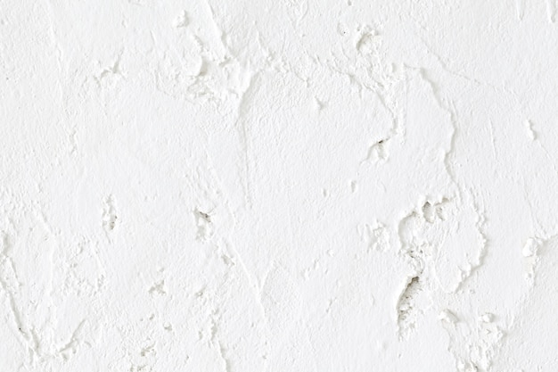 Chiuda sul colpo del fondo bianco di struttura del muro di cemento