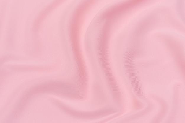 Trama ravvicinata di tessuto o stoffa rosso o rosa naturale dello stesso colore. trama del tessuto di cotone naturale, seta o lana o materiale tessile di lino. sfondo di tela rossa e arancione.