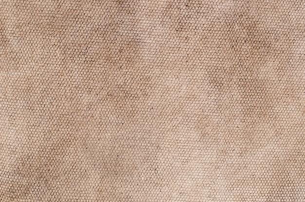 Primo piano sulla trama vecchio tessuto di tela dettagli