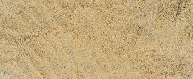 Vista ravvicinata dall'alto sullo sfondo del pavimento della spiaggia di sabbia per il concetto estivo