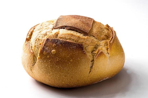 Primo piano di un tipo di pane italiano tradizionale, sullo sfondo.