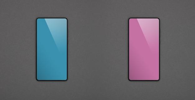 Chiudi due smartphone con schermi vuoti, blu e rosa, su uno sfondo di carta grigia, piatto, direttamente sopra
