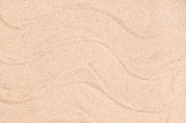 Vista del primo piano del concetto della sabbia di estate