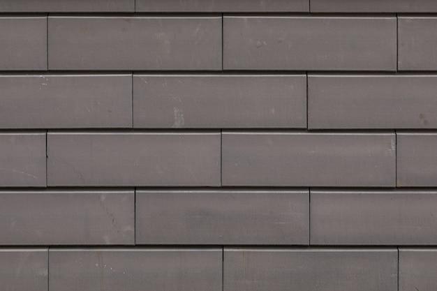 Primo piano del muro fatto di mattoni di cemento