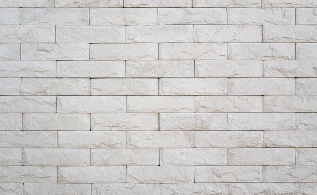 Un primo piano di un muro di mattoni bianchi