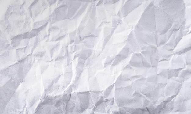 Priorità bassa di struttura di carta sgualcita bianca del primo piano.