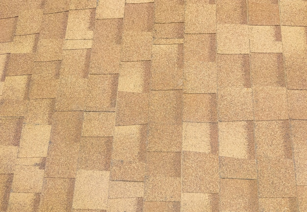 Primo piano del tetto in scandole di asfalto