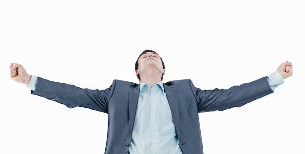 Primo piano .sogni di un giovane uomo d'affari.isolato su uno sfondo bianco.