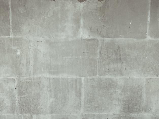 Primo piano sul fondo di struttura della parete di mattoni all'aperto di pietra grigia