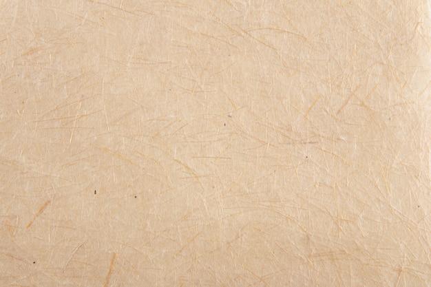 Primo piano della priorità bassa di struttura di carta fatta a mano. carta riciclata.