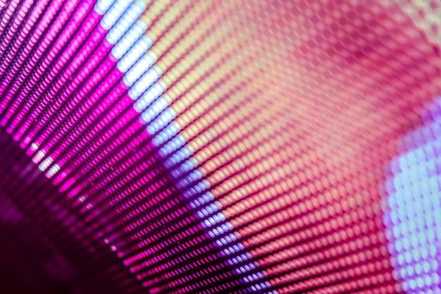 Schermo sfocato led closeup. sfondo di messa a fuoco morbida led. sfondo astratto ideale per il design.