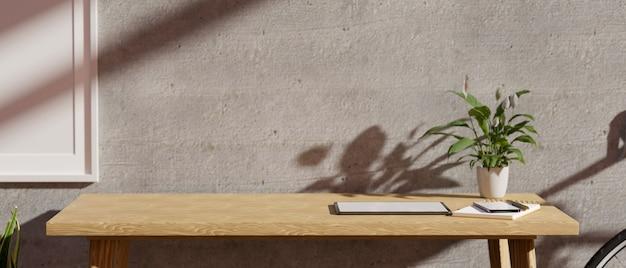 Primo piano moderno e minimalista posto di lavoro con copia spazio su un tavolo di legno contro il muro di cemento grigio 3d