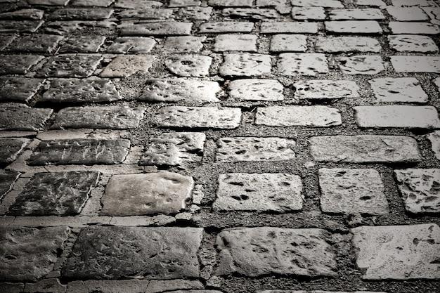 Primo piano di vecchia strada del ciottolo