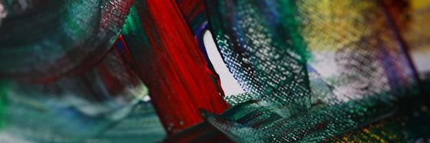 Primo piano di pittura con colori acrilici su tela