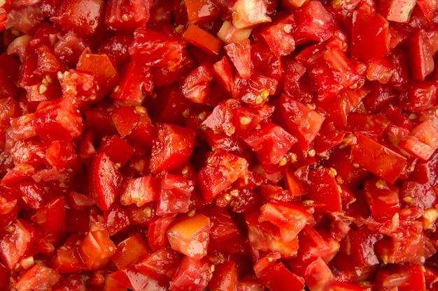 Primo piano sulla priorità bassa rossa di struttura del pomodoro tritato
