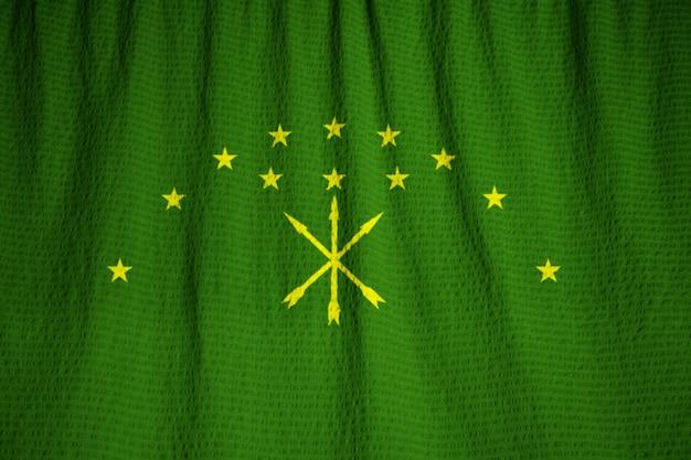Primo piano della bandiera arruffata di adygea, bandiera di adygea che soffia in vento
