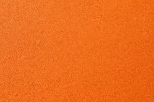 Primo piano della struttura in pelle arancione senza soluzione di continuità per lo sfondo