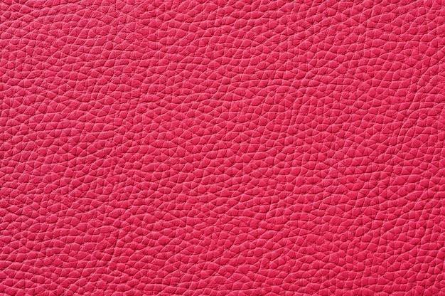 Primo piano di texture in pelle rosa senza cuciture per lo sfondo