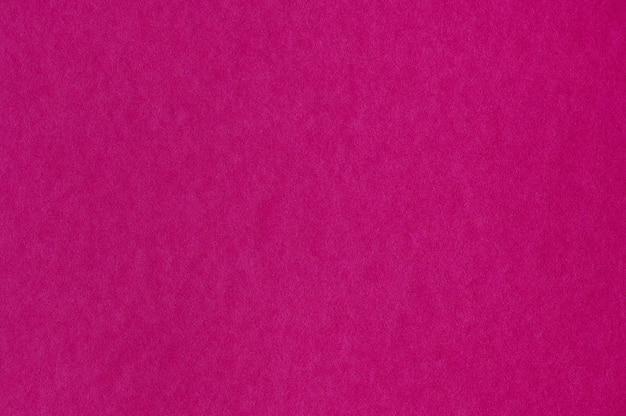 Primo piano di texture di carta rosa senza soluzione di continuità per lo sfondo o le opere d'arte