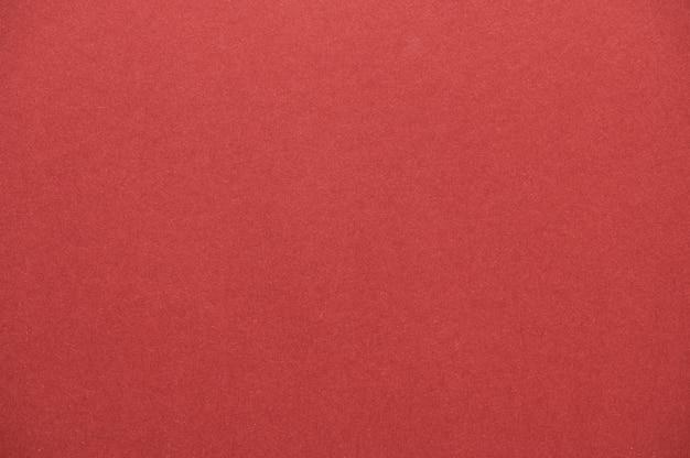 Primo piano di texture di carta rossa senza soluzione di continuità per lo sfondo o le opere d'arte