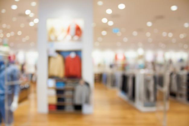 Negozio di abbigliamento boutique interno sfondo sfocato