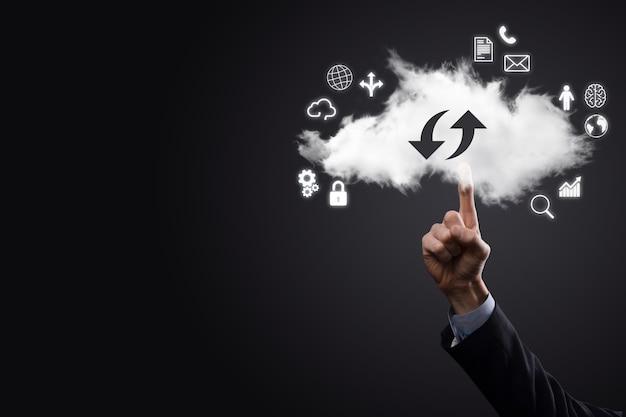 Tecnologia cloud. segno di archiviazione cloud con due frecce su e giù al buio. cloud computing, big data center, infrastruttura futura, concetto di ia digitale. simbolo di hosting virtuale