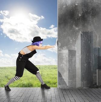 Il pagliaccio cambia l'ambiente dall'inquinamento al verde Foto Premium