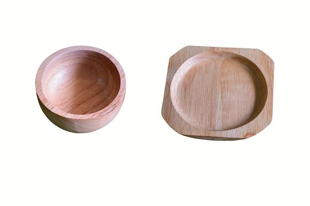 Sottobicchiere e una tazza di legno con tracciato di ritaglio.