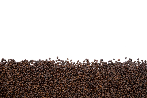 Chicco di caffè sulla tavola bianca