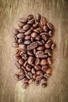 Caffè sul fondo di legno di grunge con effetto retrò stile vintage filtro
